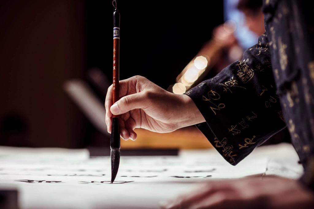 Artist practising calligraphy